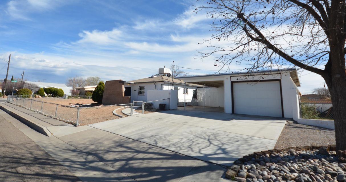 Centrally located North East Heights Home. 1/2 mile to I-40. Close to shopping and dining at ABQ Uptown, Coronado & Winrock malls. Newly maintained roof. Garage space plus carport parking. Mastercool type evaporative cooler. Updated windows & Kitchen appliances. House is clean and move in ready, with neutral paint waiting for Buyer to make their own. Home has tons of storage with shelving in place. Heated 275 SF workshop with electric. Come see this nice home at a great price!