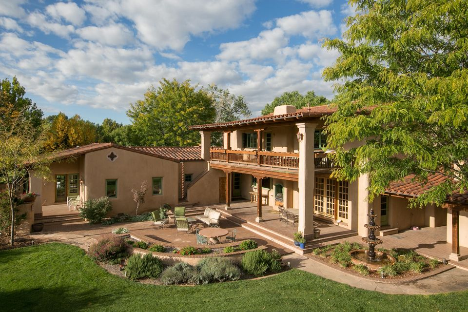 A remarkable experience awaits the most discerning of buyers. This incredible adobe home crafted by award winning adobe homebuilder CE Laird for his family is truly an experience. Nestled in the lush North Valley along the bosque and surrounded by beautiful cottonwood trees lies a genteel country estate. A Mediterranean home named ''Casa Santa Barbara'' is the centerpiece of this lovely property and features hand troweled plaster walls, hardwood floors, terra cotta roof tiles, intricate beamed ceilings, and remarkable adobe craftsmanship. All bedrooms feature en-suite baths and walk in closets.A wonderfully appointed guest house is waiting for your visitors. Wonderful outdoor living areas with breathtaking views of the Sandia Mountains complete this remarkable compound.Truly one of a kind.