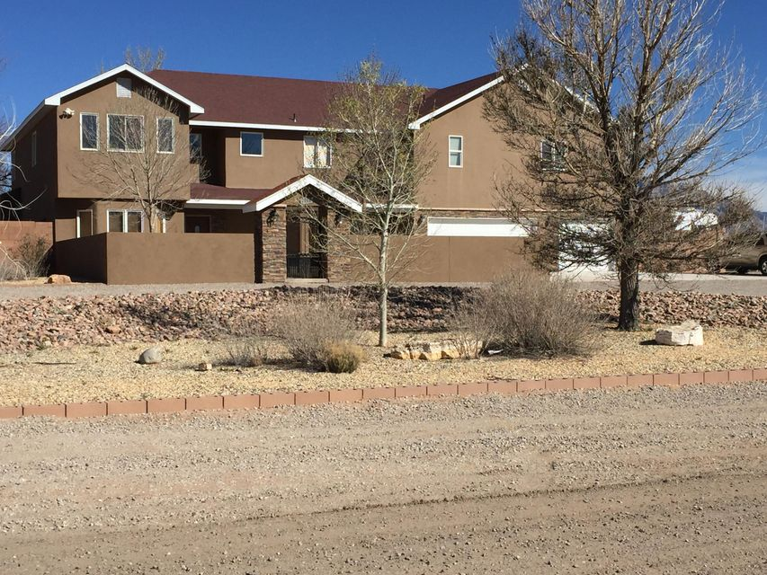 Very nice custom home on full acre lot with great views of the Sandias and city lights. Lots of amenities. Pool (w/auto cover & vac., very low maint.)gazebo,,tennis court,hot tub oversized RV garage with lots of storage space. Large master bed room. Master bath has jetted tub, separate shower with sauna. 5 b/r's 4 baths. Great family home. A must see.