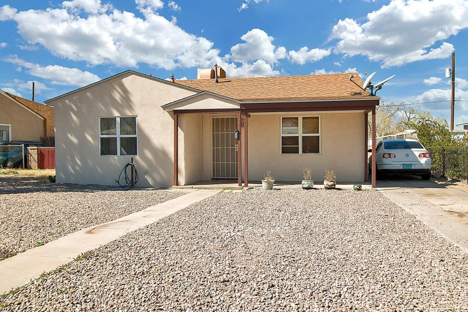 Great home, great location. Synthetic stucco done in 2014.  New roof done in 2012.  Massive, spacious master bedroom.  Tile throughout the home.  Large eat-in kitchen.  Backyard access via side of te home and the alley in the back. Oversized detached garage in the back of the home. Views of the Sandias.  See it and make it yours today.