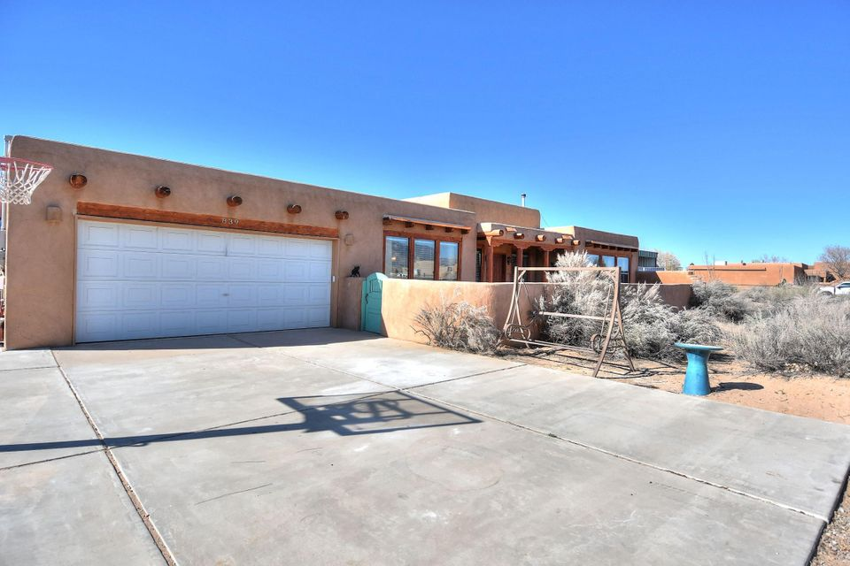 CORRALES Views Views Views! Come check out this Frank Larabee Custom Built, Southwest Pueblo Style Home! Built on .75 acres. Large corner lot with Amazing views! Wood package includes beams, corbels and vigas. High end laminate wood flooring. Serene outdoor entry leads to front door. This 3 bedroom, 3 bathroom home includes a large multi purpose bonus room with outdoor access to back yard, a pellet stove in main living area, open kitchen, dining room, seperate laundry room and 2 car garage. Solar panels (about 40) are owned and convey with property with warranty (See Documents). Fenced yard. Great for horses/pets. TPO roof has warranty, new heating and cooling system and new water heater.