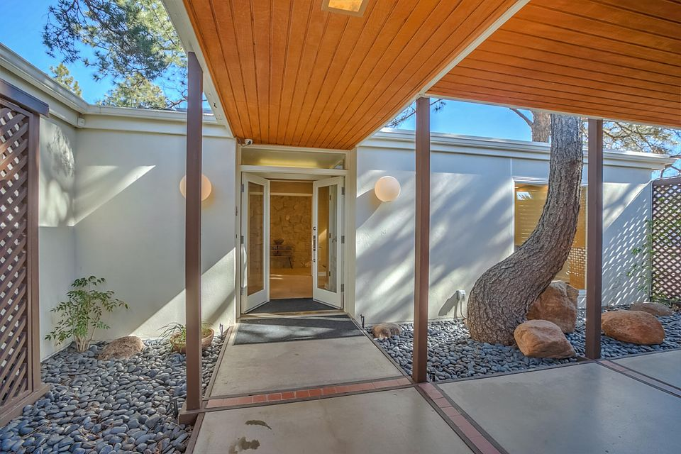 Situated in the heart of Albuquerque on an Oversized Four Lot Parcel (.50) is this Classic Mid-Century Modern Designed Estate Home. Completely remodeled with multiple master suites and living areas, plus an oversized separate guest house, w/indoor pool, hot tub and sauna (the indoor pool is not Included in the overall Sqft). ECOsmarte water purification system serves the home, pool and spa, creating a pristine chemical free experience!   Enjoy meticulous attention to every detail. The entire estate has been walled and secured, for the utmost privacy. Lush grounds and open air entertaining spaces surround the home, creating exquisite venues for gatherings, both intimate and grand. Please See the attachments for a complete list of upgrades! This home is truly a one of a kind estate!!