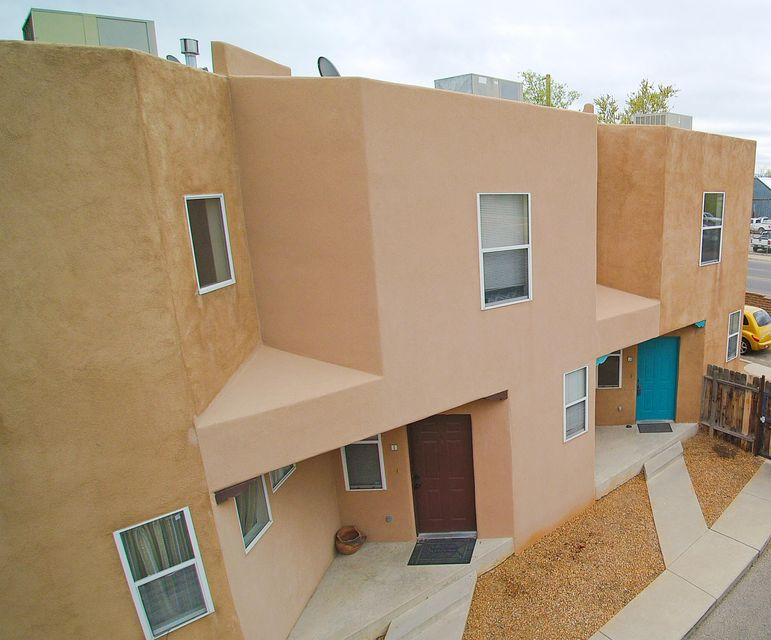 PRICE REDUCED! Two story condo in Plaza Chamizal gated community. Great location, Conveniently located near I40 & I25,  just minutes from Old Town and Downtown Albuquerque. Perfect starter home or investment opportunity. Currently the HOA dues are $135.00/month which includes Telephone services for the call box, water, trash, assigned parking and monthly grounds maintenance. Call a Realtor today to schedule your showing.