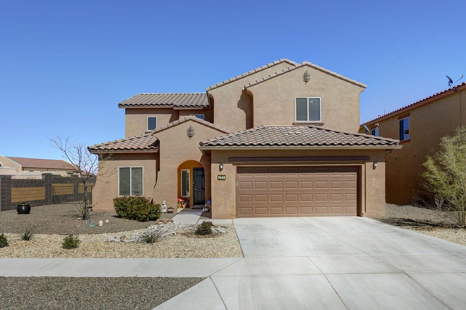 Enjoy this Luxurious 'Sapphire' (with LOTS OF EXTRAS) by PULTE in the Boulders without the cost of a new build & upgrade fees.  Spacious & flowing floor-plan includes 5 Bedrooms w/ 4 full baths, office, & 1st & 2nd floor living areas... Master Suite, Office & 5th bedroom on main level (perfect for In-Law suite).  Energy Efficient upgrades incl: Tankless water heater, Low-E windows, water softener, build-in humidifier, & HE washer/dryer.  Elegant upgrades continue w/ high vaulted ceilings, gas fireplace, hand-scraped hardwood floors, granite counters, birch cabinets, large kitchen island w/ under-mounted sink & stainless appliances. Resort style landscaping in the east facing backyard incl fountain, built-in grill, raised seating area and views of the Sandias!  Home warranty INCLUDED!