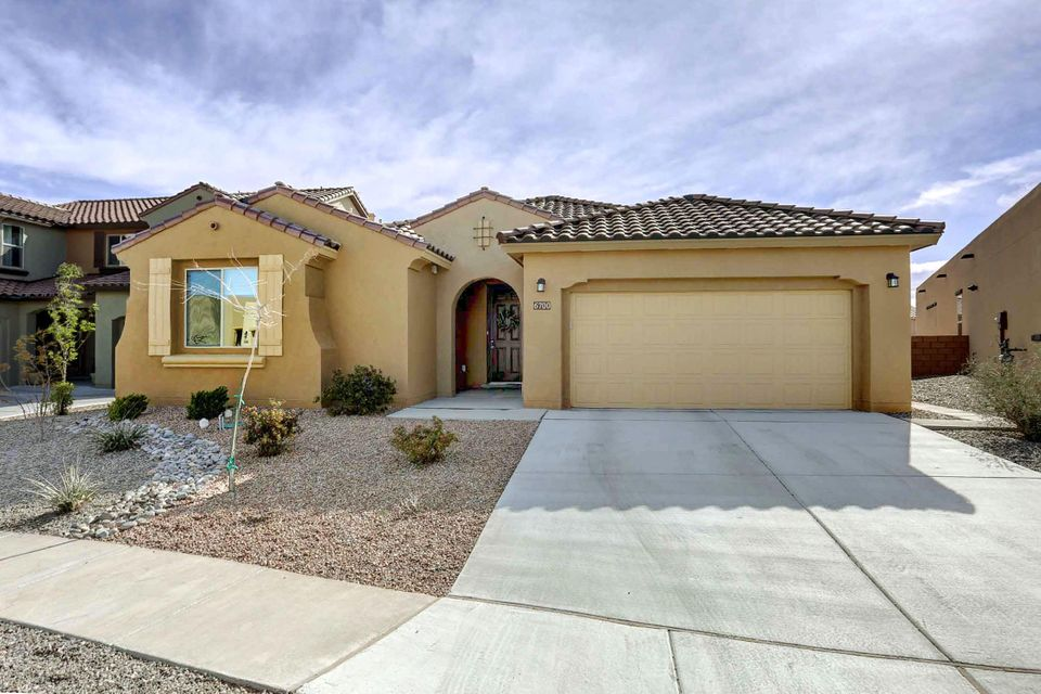 Beautiful single story Pulte home in desirable Montocito West with NO PID! Award winning Parklane floor plan with 2675 square feet, 4 bedrooms and 3 1/2 bath that includes a guest suite with it's own bathroom! The gourmet kitchen includes a stainless steel Kitchen Aide package, a double oven and built in range. The master bathroom has double sinks with granite counter tops and the closet has a tall closet shelving system. The many energy efficient features include Lenox air conditioner, tankless water heater and low-e windows. The extra two feet added to the back makes this one of the biggest floor plans in the area and to top it off it has a fantastic view of the Sandias!