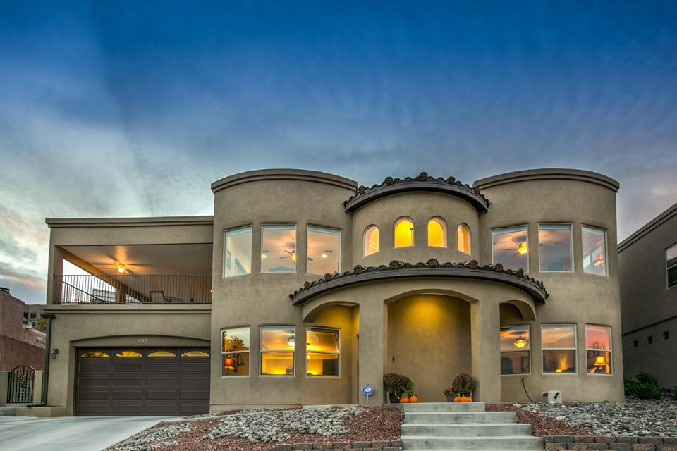 This exquisite custom build home has unbelievable views of the bosque and downtown. You will enjoy the bright open floor plan, spacious kitchen with granite countertops, stainless steel appliances, custom tile backsplash, double oven, and island. The master is downstairs with a luxurious bathroom, doorless walk in shower, his and hers vanities, separate jetted tub, and huge master closet. Upstairs you will find an executive office with hardwood floors which could easily be a 4th bedroom, 2 bedrooms with jack and jill bathrooms with separate vanity areas, walk in closets, and access to the back yard. Outside you can enjoy a spacious oversized balcony with an outdoor kitchen area, plush green grass, a concrete pad for toys or basketball, tiered wall with upgraded brick, and incredible views!