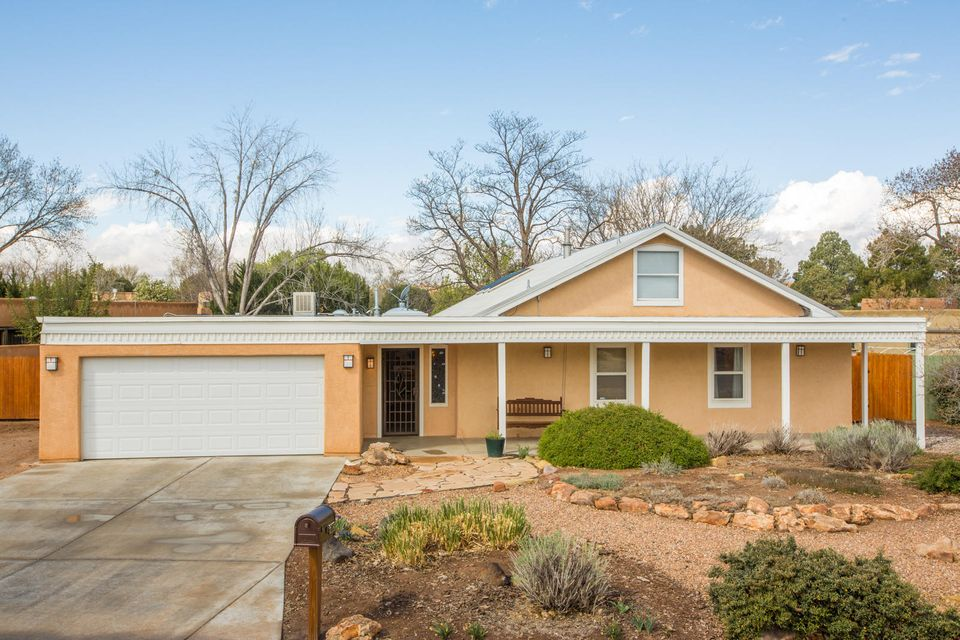 Gorgeous home in desirable Thomas Village!  It has been totally remodeled and the addition of a separate master wing with a 2nd living area makes it perfect for extended families!  Beautifully redone kitchen with custom cabinetry, silestone, Jennair stove and a breakfast bar.  The dining area looks out onto the gracious back yard.  Spacious living room with fireplace.  Custom lighting and tile through-out.  Beamed cathedral-style ceilings.  Custom deck leads to well-maintained backyard with grass and mature greenery.  The second master and second living area have scored concrete floors, radiant heat & separate evap cooler. Oversized garage, standing metal roof and Eagle window package.  The master bedroom boasts and office with built in bookshelves. Professional floorplan attached!