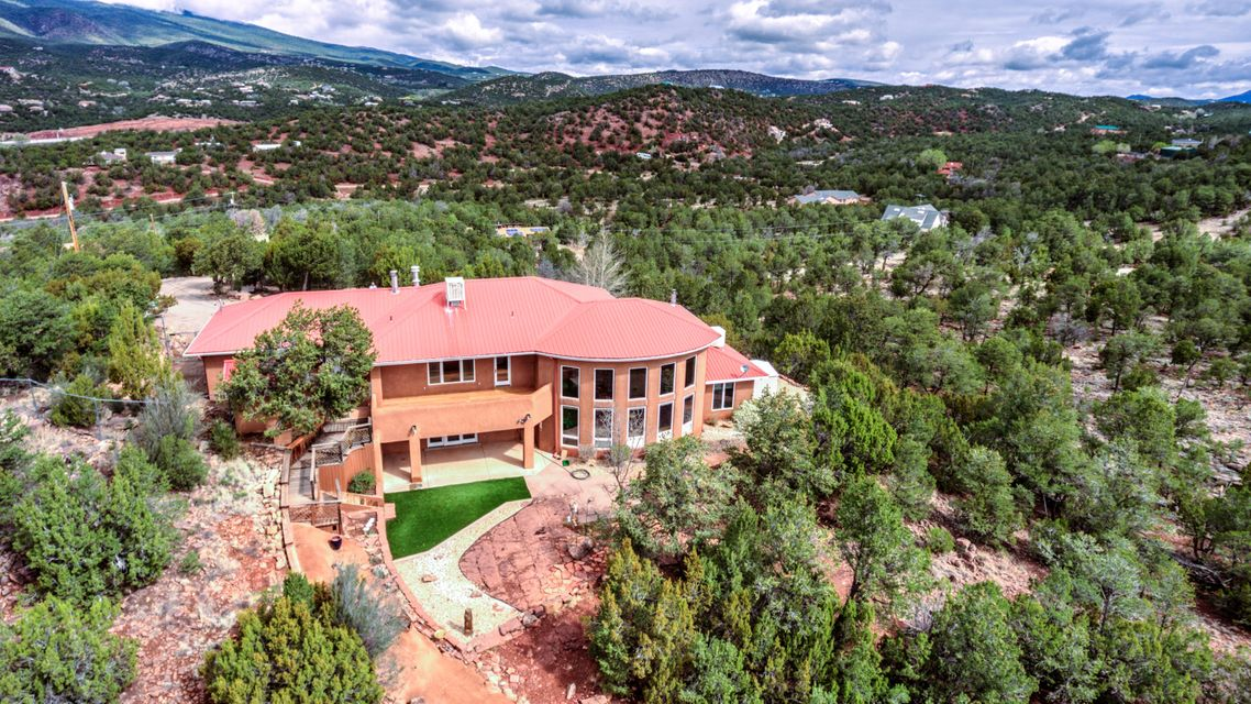 OPEN house 4-30-17 from 1pm to 4pm - 'Wow, we did it! We are truly living the good life'' is what you will say if you make this DREAM Home yours! Unbeatable Location (less than 7 miles to Smith's on Tramway - total privacy, & one of the most well built and well loved homes in the mountains! Add all the welcoming outdoor covered patios/decks & you will have almost 5000 SQ FT under roof! This Lovely Custom Home has A Welcoming Foyer overlooking the Beautiful Great Room w/ Southern Mountain Views! Large Dining Room & Sunny Updated Kitchen. Office/Library w/ great views off the Master Suite! Newer Baths, Fabulous Master Suite with Redwood View Deck & More. Beautifully Landscaped Front & Back Yards, 750 Sq. Ft 3 Car Garage