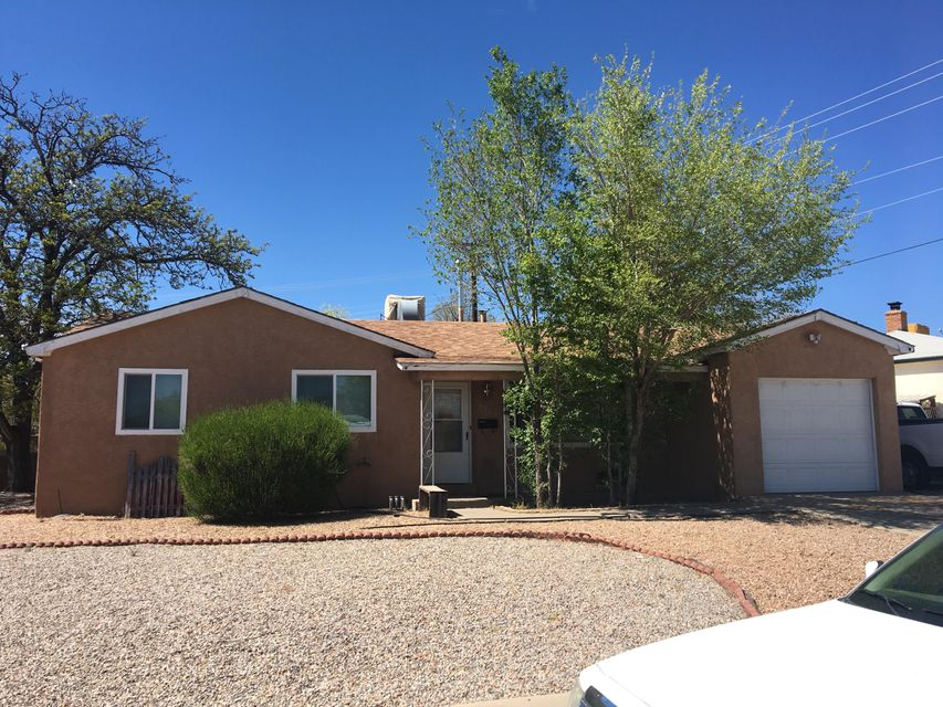 NE Heights!  3/br, 1.75/ba, with some really nice improvements.  Newer windows, French doors leading to large covered patio, laminate/tile flooring, beautiful EZ care landscaping F&B.  Woodburning FP in living area.  1 car attached garage with opener and only a city block from Snow Park.