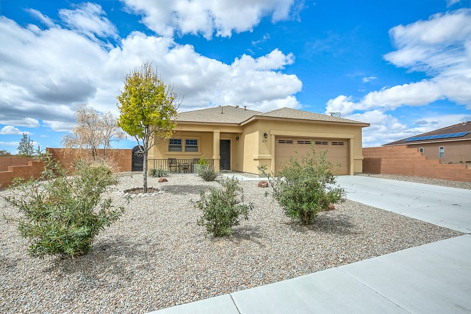 Incredible Green built, GOLD LEEDS Home, with Photovoltonic Solar Panels! Over 20k into this incredible backyard with raised walls on both sides and custom gates! Backs to Linear Park open space for awesome sunset views! Additional upgrades to the Interior within the   last 6 months to include: granite countertops in kitchen and tile backspash, top of the line stainless gas range/refrig and dishwasher! New upgraded carpet in bedrooms! Crown moulding in greatroom & bedrooms! New cultured marble countertops in both bathrooms, over 16k! Totally a fabulous Energy Efficient home with a 5 star home energy rating! Home shows immaculate!