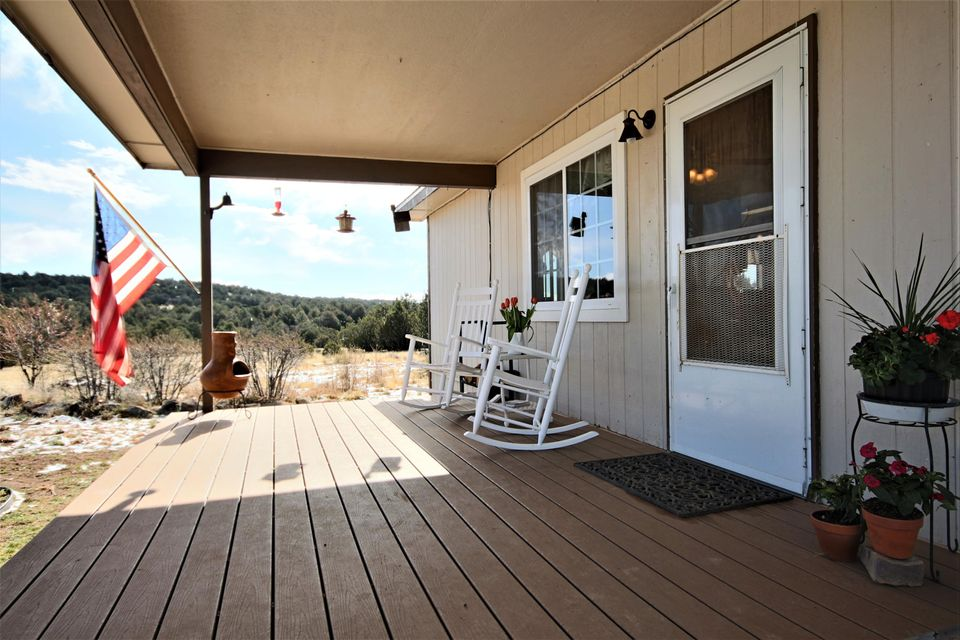 End of the road paradise! Amazing setting. One of the most beautiful places that you'll find in all of the East Mountains. This home features an all new Kitchen. Bring the horses. Ride through the rolling hills right from your ranch. This home is also available on 10 acres.