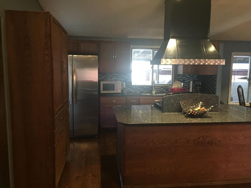 ADORABLE...PRIDE OF OWNERSHIP...A MUST SEE. GRANITE KITCHEN WITH WORK ISLAND, LAMINATE FLOORS. MASTER WITH UPDATED BATHROOM, LIVING AREA WITH TV WALL. REFRIGERATED AC/HEATER COMBO IN 2015. ENTERTAIN IN A 13X70 COVERED PATIO WITH BUILT-IN GRILL WITH WATER SUPPLY. RV PARKING POSSIBLE.