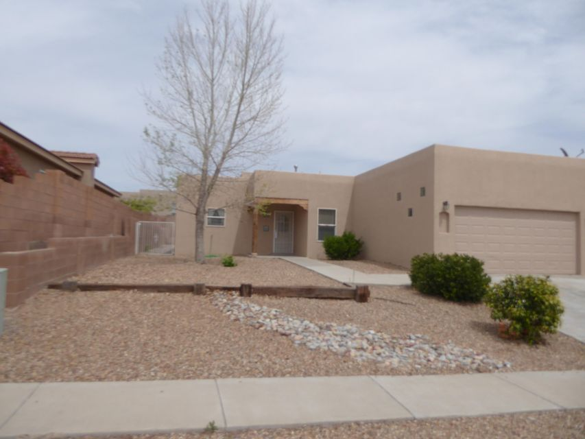 This 4 Bedroom home has so many AMAZING features!! New Carpet and paint throughout the home! NEW GRANITE in kitchen and both bathrooms!! The large Master bedroom offers double sinks in masterbath with a separate shower and large garden tub! The vigas and tile flooring in living room give it such a warm New Mexico feel. This home is ready for a new owner!!!