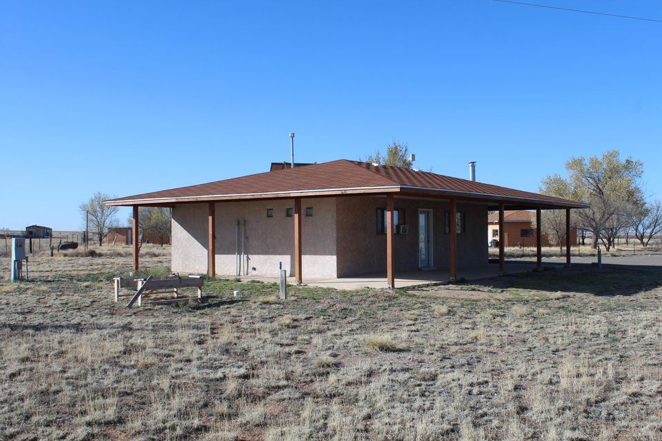 This is a one of a kind opportunity to own an amazing property in Moriarty.  2.8 usable acres come with this home, on a paved road, forever views of the Sandia Mountains and Pecos Mountains.  The home is a large studio layout with space for a bedroom, living room, dining room, kitchen, and an updated 3/4 bath with a walk in closet.  Property improvements include mature landscaping, partial fencing, grassy area, RV hook ups, a private well, and wrap around porches to enjoy the cool evenings in the country.  If you've always wanted to live the rural lifestyle and still be close to town, this is your opportunity to do so.  Owner is willing to work with a REC on this home as well.  Make and appointment to view this home today!!