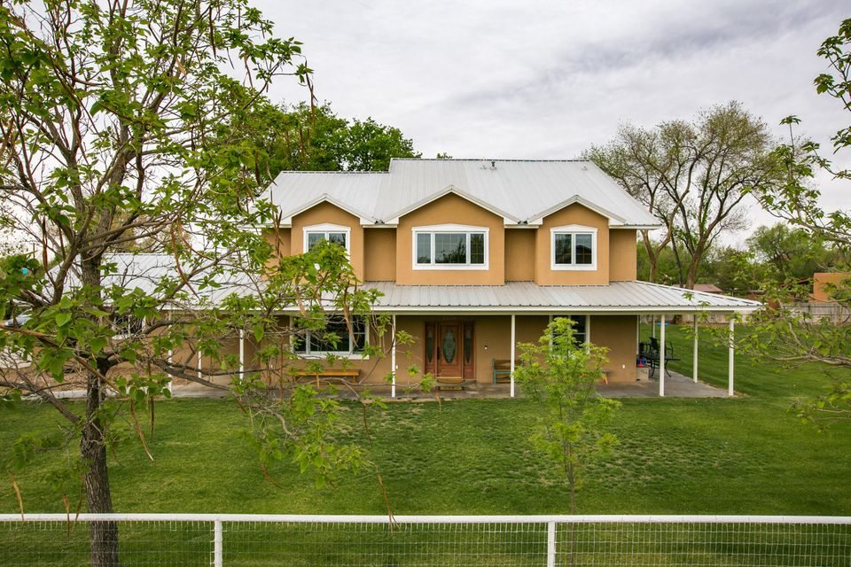 Sitting on an Acre, this Pristine North ValleyHome has aSpacious Floorplan, withGourmet Kitchen,including a wrap aroundIsland,Granite Countertops, Custom Cabinets, andStainless Steel Appliances. Exceptional Hardwood Flooring throughout, with Custom Molding and Cathedral Ceilings. Double-sided Fireplace separates the Diningand Formal DiningAreas. Lower level includes 2 bedrooms w/ Bay Window Seating, Walk-In Closets, and Jack-&-Jill Bathroom. Upper level includes a Generous Owner'sSuite, French Doors leading to the Newly Renovated Master Bath, including Radiant Flooring, Granite Countertops, Cathedral Ceilings, JettedTub & Romantic double-sided Fireplace. His and Hers Walk-In Closet, with Storage and Shelving. Come view this rare opportunity, in the heart of the North Valley!