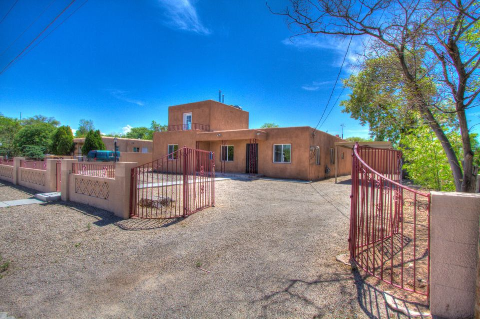 Rare opportunity This property is being sold 3 ways main house on large .30 acre lot. on the adjacent lot a duplex and another home on back lot. Sold all or part. Call listing agent for details.Main home is great all remodeled new stucco, windows , Kitchen, custom draperies. Must see.