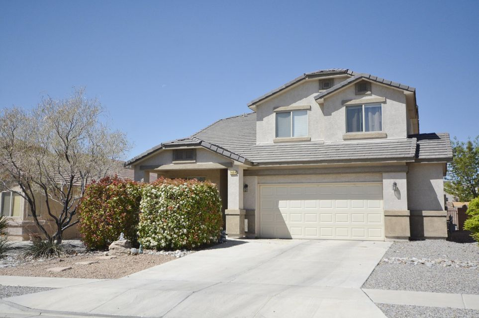 Desirable Cabezon neighborhood!  POPULAR PULTE floor plan featuring two living areas, dining room, 3BDR/2.5 BATH PLUS a loft/flex room!  Large kitchen features a work island, pantry, built-in microwave,  gas stove, and breakfast nook.  Oversized great room is open to the kitchen and features raised ceiling and a gas fireplace.  Huge master suite has two walk-in closets, double sink, garden tub and separate shower.   Covered patio has a gas stub out for BBQ for outdoor entertaining.  Excellent location in mid Rio Rancho, close to Rust Medical Center, parks, schools, shopping, movie theater and post office.