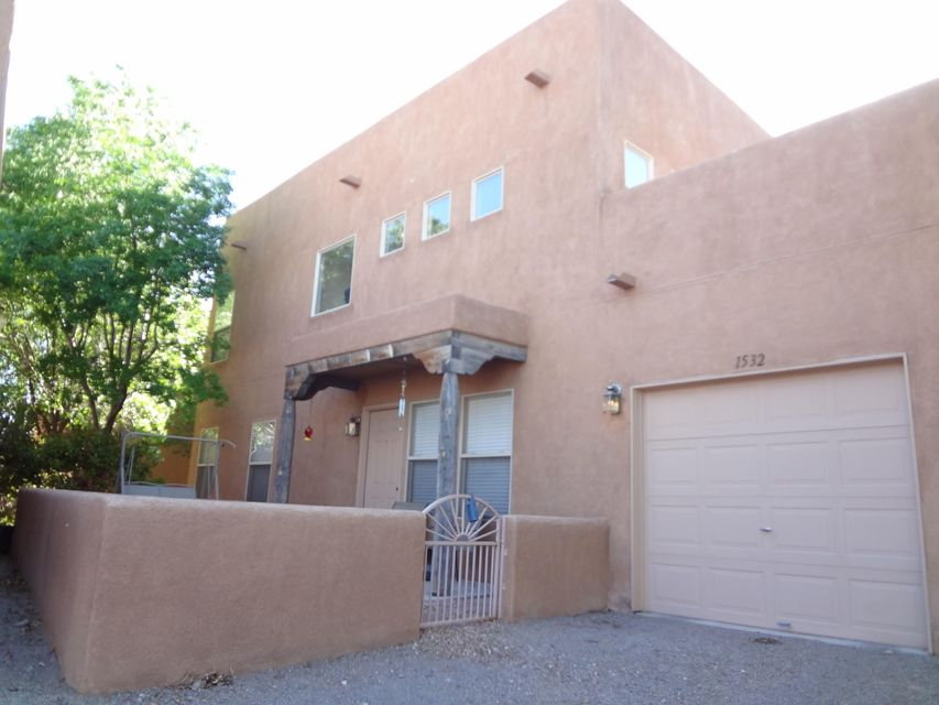 Beautiful home in highly sought after Los Jardines neighborhood in the North Valley. Home offers partial mountain views, 2 large bedrooms, 2 full bathrooms, stainless steel appliances in kitchen (refrigerator also conveys), laminate, tile and carpet flooring, high 18 foot ceilings, ceiling fans, electric car connection in garage, beautiful private courtyard with its own water feature and low maintenance yard. Refrigerated air and heater unit installed in 2009 and water furnace installed in 2011. View this property today - will not last!!!