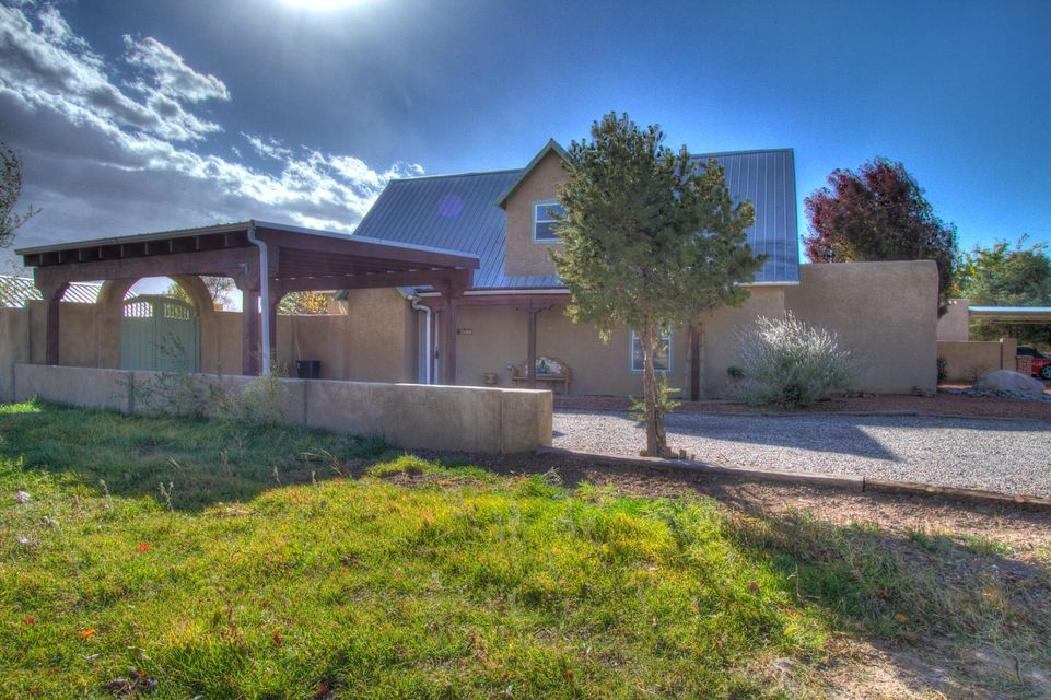 Cozy cottage feeling home in Bernalillo. This home has been impeccably maintained. This lovely 3 bedroom 2 bath home is situated on a view lot with newer in ground gunite pool. Open light and bright beautiful kitchen. Master is up stairs and has ''A'' Frame look with french country bath room. Hard wood floors up stairs.Detached garage is in back and would not work for everyday car parking. would be a great shop or storage art studio. Back yard access is a big plus. gorgeous landscaping make this a great opportunity for a home in turn key condition.