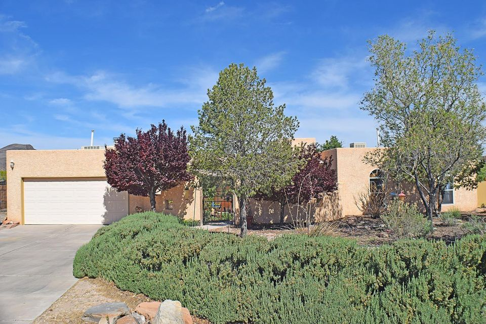 This intriguing pueblo style home is situated on a large lot, which is conveniently located near quick freeway access, shopping and schools. The private and lush courtyard is comfortable and complete with a covered patio. Kitchen is spacious and has recent updates, including upgraded appliances. There is plenty of space for entertaining with the breakfast nook, formal dining area, living room and enormous family room. The generously sized master bedroom includes a cozy fireplace, enormous walk in closet and master bathroom features double sinks, separate tub and shower. Back grand courtyard offers a private escape from the city life. The 15x30 workshop provides an ample space for your hobbies. Backyard access available. Don't delay, make an appointment to view this incredible home!