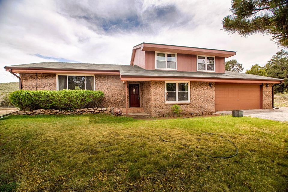 Beautiful home*good floor plan w/ special spaces. Wonderful living area w/engineered hardwood flooring merging into a beautiful dining room area*Upgraded tiled kitchen*plentiful cabinetry*island*tasteful corian counters*stylish and convenient. Master Suite is a retreat*few steps up*very private*provides solitude and respite w/a separate dressing area or nursery*large walk-in closet. Gorgeous vanity & spacious newer shower and counters! All newer hardwood flooring*Very nicely appointed. 2nd Spacious Guest Bedroom w/guest bath nearby! Peace and quiet! Downstairs, a phenomenal den area for guests to gather and enjoy entertainment w/comfort of pellet stove on chilly spring evenings. Great large sliders to savor the paradisaical views of amazing backyard*Fruit trees*large garden area! Nice!