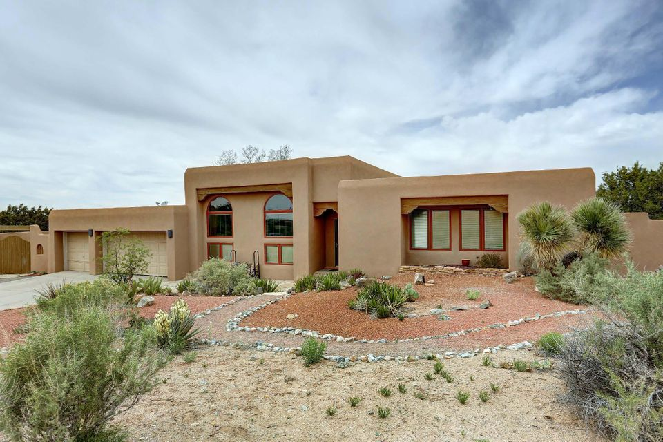Custom home complex sits on 2.88 acres.  Main house is 3200+ square feet. Sunken Great room has Australian Cyprus wood floors, custom Fireplace, custom windows looking toward the Sandia Mountains.   Large family room has brick flooring & a kiva fireplace.   Bedroom wing has 2 bedrooms plus a master bedroom suite with a sitting area, private bath, walk-in closet & private patio.  Mother-in-law quarters has double doors leading to a sun-room & private bath.  Back yard features an in-ground swimming pool with hot tub.  Outdoor fireplace with private patio and bunco seating.  Garden plots throughout. A separate two story building has a small casita or studio on main floor with a work shop underneath.  Has a separate drive to the shop area.  Come see it and love it!