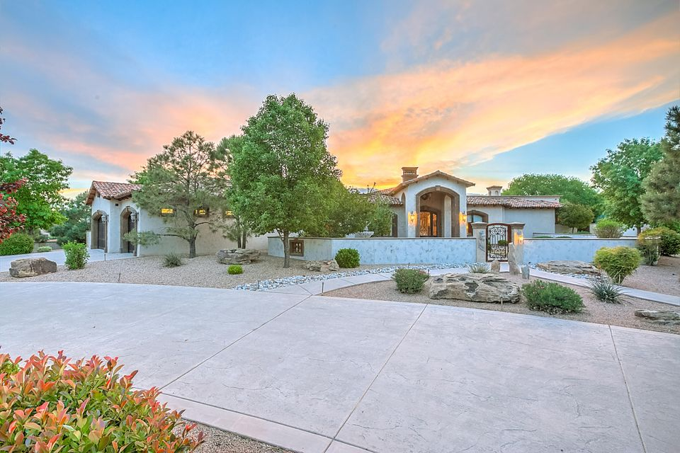 Come experience one of the elite and magnificent Luxury Custom Tuscan Properties of Albuquerque. This .75 ac single level dream home offers Elegance, Sophistication, Luxury & Backyard living that looks as if it is out of the pages of AD (Architectural Digest).  4 over-sized bedrooms with 4 custom bathrooms, Plastered walls from top to bottom, Custom knotty alder cabinetry, Knotty Alder over-sized interior doors, Cantera stone, Old world columns,  resort style backyard with custom pool and fully landscaped with a family friendly design.  This Mansion is situated in the most desirable part of Black Farms and move in ready.