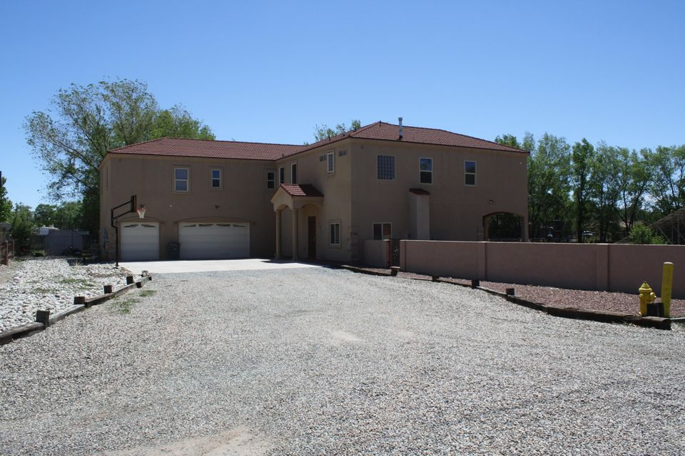 Beautiful spacious  South Valley home. Home features 4346 sf with 5 bedrooms, 3 full baths, an office, loft, great room, family room, balcony off of master bedroom. This home is nestled on semi private driveway with 3/4 of an acre. Kitchen includes granite counter tops, breakfast nook soaring ceilings and ample cabinet space. The kitchen opens into generous great room with built in stone fire place, large windows allowing natural sunlight. First floor finished hardwood flooring, Venetian finish throughout the home. Additionally features include extended covered backyard patio, 3 car garage with ample storage, workshop 24'x 30'.  Recently installed solar power.