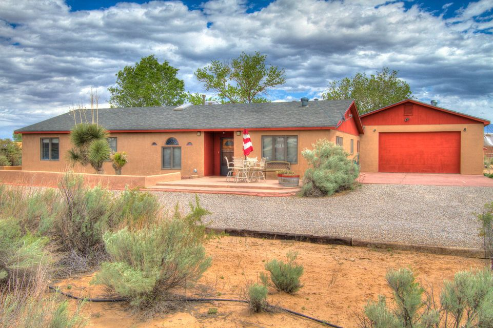 Beautiful 1 acre horse property in Corrales. This just over 2000 SQ Ft home offers 4 bedrooms 2.75 baths. 3-4 bedrooms ample storage. Lots of light this is an artists home. 750 SQ ft drive thru garage with 3/4 bath and sink. Open kitchen. Big storage,hot tub. Mountain views. This home is a must see.