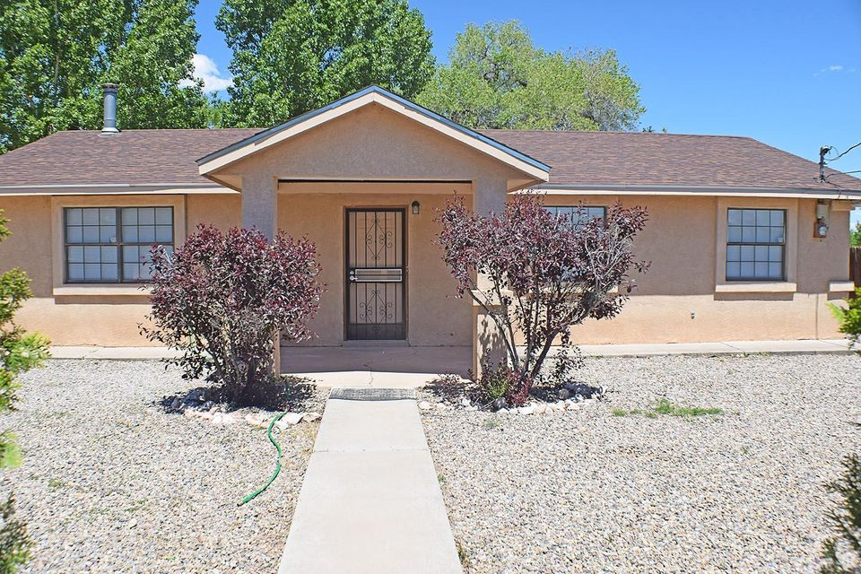 This is a hard to find gem in Los Lunas, commercial has been approved in the past.  The home boasts a huge family room, three bedrooms and two bathrooms.  Beautiful back yard next to irrigation ditch.  Close to shopping and grocery stores.