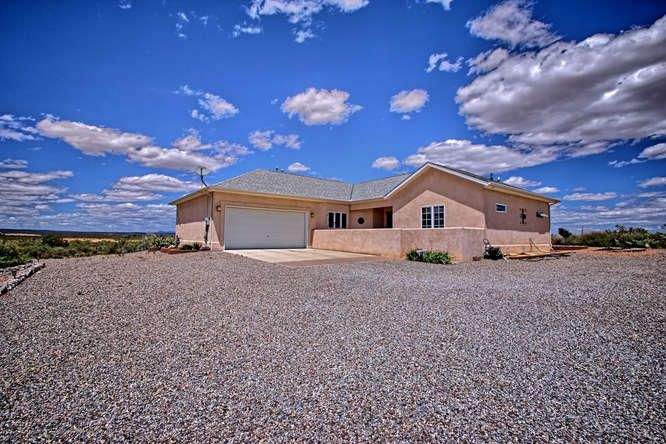Custom built home with views in close-in location in Rio Rancho. Pellet stove, 2x6 Construction, oversize two car garage w/sealed floor, integrated foam block foundation, Vaulted ceilings w/custom ceiling fans, security system, maple cabinets, Granite counters & stainless steel appliances, city water, backyard deck, refrigerated AC and Gas CFA, water softening and filter systems, four foot high crawl space under house for access to plumbing, attic for storage, Master bath with walk-in shower, jet tub, and double vanity with granite counter.