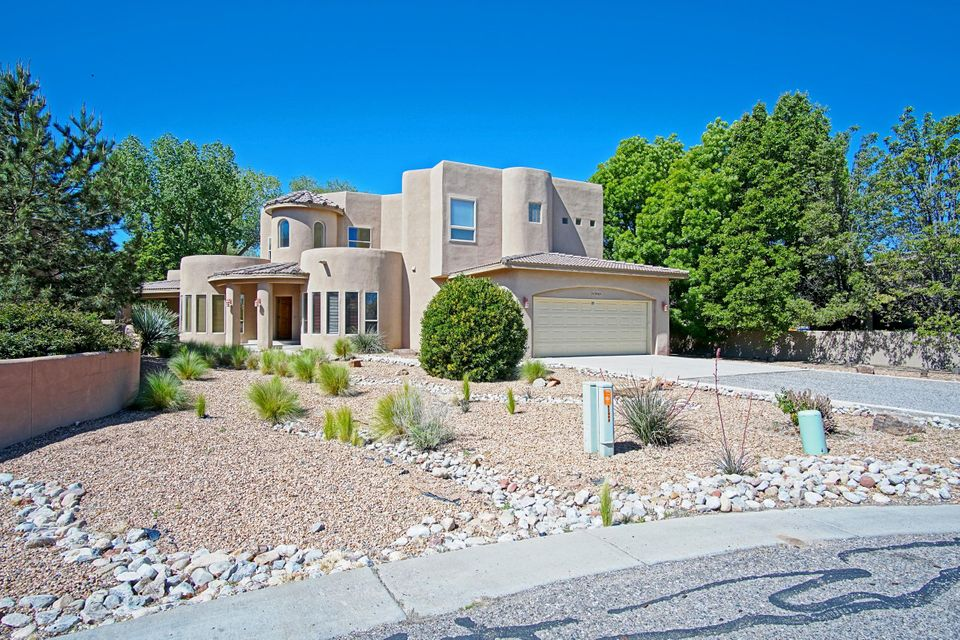 Price Reduced $40,000!!! OPEN HOUSES Saturday, June 24 from 11am-3pm and Sunday, June 25 from 1-3pm! Wonderful opportunity to live in the heart of the North Valley in this beautiful custom home. Property is located in a quiet-tranquil neighborhood on a private cul-de-sac bordering the Los Poblanos Open Space. Enter thru the majestic entryway into great room w/soaring cathedral ceilings and kiva fireplace. Entertainer's kitchen has granite counter tops, stainless steel appliances, plenty of cabinet space, and breakfast nook. Formal dining room w/built-in cherry cabinetry. Private office and Jack-n-Jill bedrooms on main floor. Majestic master suite spans entire second floor w/ loft space and balcony. Patio off master overlooks private back yard.Beautiful mountain views!