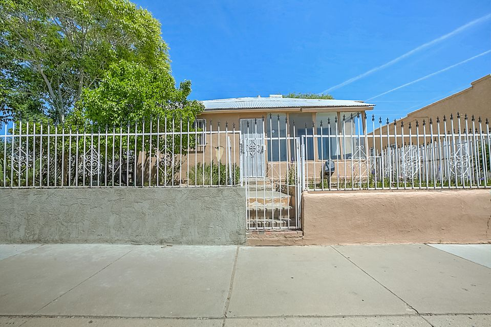 Adobe home with TONS of potential.  2 minutes from down town and 5 minutes from nob hill and Isotopes/UNM sports complex.  3 bedroom 1 bath on a large lot and backyard access.  This is a blank canvas, make it your own at a stellar price!  Stop reading and go see it today!  Sold as is with no repairs.  Perfect for investor.