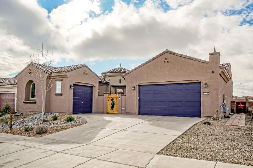 Home In Albuquerque's Premier New Del Webb Gated Community! This Beautiful Home Features All The Upgrades To Include Appliances, Fixtures, Fans, Plantation Shutters, Insulated 3- Car Garage & Tankless Water Heater. Open Kitchen To Living Area Great Features with Oversized Island & Granite Countertops. Beautiful Accent Tile Work & Barnyard Tile Floors Throughout Home,No Carpet! Don't Miss The Hand-Crafted Barn Door in The Master and & The Oversized Walkin Shower With Dual Shower Heads! Garage Also Has A Heated/Cooled Storage And State Of The Art Screen Garage Door! Xeriscaped Backyard With Raised Wall For Additional Privacy. Enjoy All The Amenities Of This Active-Adult Resort Style Living With Pool, Fitness Center, Jacuzzi, 6+ Miles Of Trails Backing To Petroglyph Nat'l Monument.