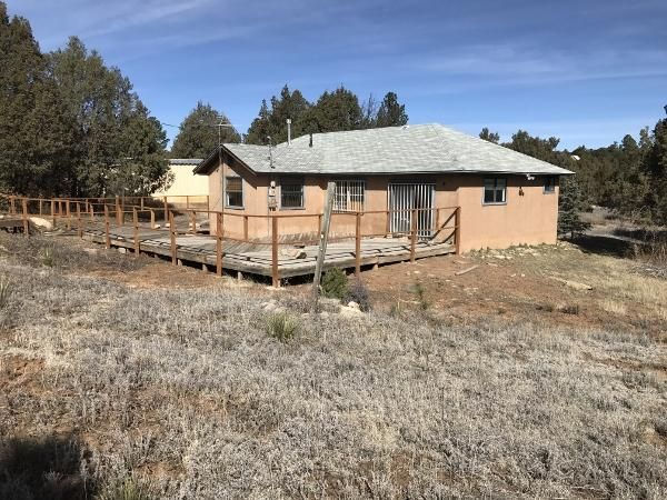 Come get away from the city to this amazing opportunity for the handyman or investor.  Home features 3 bedrooms 2 bathrooms on three amazing acres. Home is nice and secluded back from the street, huge deck in back and is waiting your creativity. Large workshop for your hobbies and or storage. This is a great opportunity! Come take a look