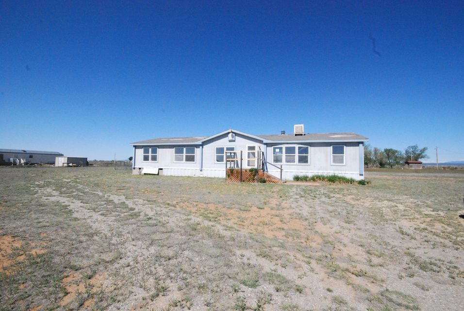 Beautiful Home w/New Carpet & Loaded w/Upgrades! Large living area includes wood burning fireplace! Open Kitchen featuring work space island and ample cabinetry! Master suite includes garden tub, dual sinks and separate shower! Great property for livestock!
