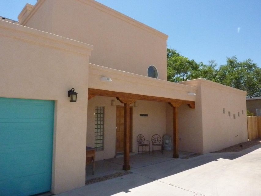 Price reduced! Located in Beautiful North Valley location, just west of Rio Grande & Griegos Rd. Home features Solar Energy(low PNM bills), 3 Bedrooms, 2.5 Baths, refrigerated air, kiva fireplace and great kitchen with granite countertops. Recent improvements include Photovoltaics, Solar panels, Combo Unit and more. Master Suite is on the main floor with jetted tub and separate shower. Master boasts fireplace, walk-in closet and french doors leading outside. Small office downstairs. Kitchen has a large island, 3 ovens and plenty of room for any cook! Nice informal dining area adjacent to kitchen with French doors that open onto backyard. Small loft area upstairs with room for extra family & friends. Plenty of storage space plus detached storage shed stays in backyard. 2 car attached garage