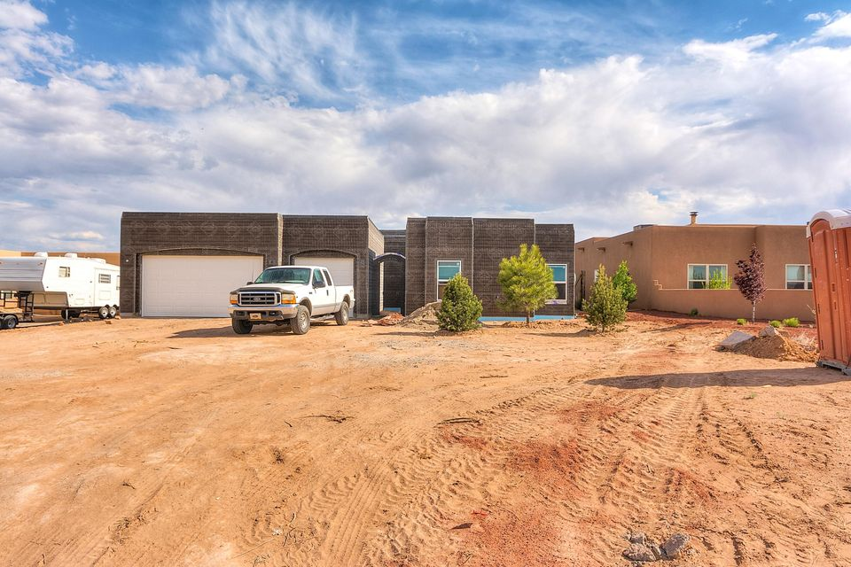 Stunning custom home on a half acre lot in Rio Rancho!  Home is just a few weeks from completion and will feature a breathtaking floorplan with many custom touches throughout.  Custom wood cabinetry, stainless appliances, high end flooring and details throughout.  4 bedrooms, 2 bathrooms, 3 car garage on a single story!  This home is beautiful!