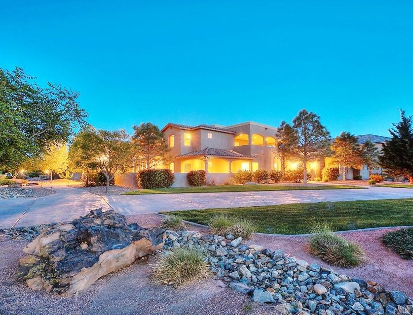 Nestled in the Beautiful Bosque just west of the Rio Grande River in Prestigious Black Farm Estates. This one acre estate will captivate you from the moment you enter.  Enjoy entertaining in the enormous chef's kitchen that opens to a fabulous great room and gorgeous outdoor living space.  Amenities include, polished granite, wolf double ovens, 48'' wolf cooktop with griddle, sub zero refrigerator, video surveillance, solid 8' custom wood doors, abundant storage oversized laundry,  master bath includes his/her walk-in closets and steam shower. Abundant storage throughout. Need storage for your toys?  The 4 bay garage has an attached heated/ cooled 28 x 32 RV/workshop with 220 outlets, closets and 3/4 bath. The separate guest house is perfect for welcoming visitors or  in-law quarters!