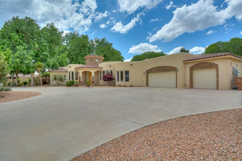 Stunning southwest style Hemlick home located in the beautiful Entrada Corrales neighborhood! Home features 3,800 sf with 4 bedrooms, 4 bathrooms, an office, 3-car garage and your own private oasis with pool and hot tub. Spaciously designed open floorplan. . Travertine flooring throughout the home. Large living area with Kiva fireplace. Gourmet kitchen with custom cabinetry & crown molding, granite countertops, detailed backsplash, built-in double oven, 6 burner gas cooktop, range hood, & a prep island w/ sink. Master suite w/ fireplace & outdoor access. Bath hosts his/hers sinks, deep garden tub and a huge walk-in shower w/ slate surround. You will be in awe of this professionally landscaped backyard w/  in ground pool, hot  tub, pond, pergola area w/ seating & grill & even a playground!