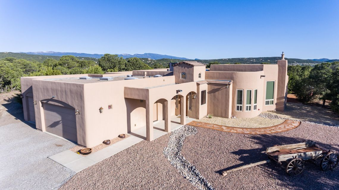 OPEN HOUSE -  Saturday, May 20th 1-4pm - Welcome to Sandia Mountain Ranch!!!What a beautiful area to enjoy mountain living & be surrounded with trees, fresh air, blue skies and views of the Sandia mountains.  This gorgeous home is waiting for your family and friends to enjoy the open floor plan with kitchen, great room & dining room combined with nice cathedral ceilings & exposed beams.The kitchen is a dream with beautiful granite counters and stainless steel appliances. Theres a second living area that can be enjoyed by the whole family.  Enjoy the warmth from the pellet insert and radiant heat during the winter months & enjoy the back covered patio for all your cookouts & during your free time saddle up the horses, property comes with a corral, hay barn with electric & water.