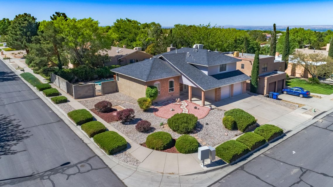 Beautiful corner lot in Cherry Hills! This home has fresh paint, new stainless steel kitchen appliances, new carpet, updated electrical panel and a 36x16  Gunite Pool with auto cover.  This classic split level has 3 bedrooms 2 1/2 bath with a bonus office/loft.