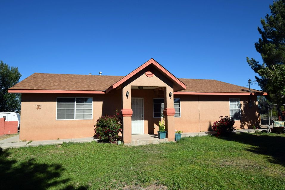 Beautiful ranch home that sits on 2.33 acres. this home has an open spacious floor plan, that comes with 3 bedrooms and 2 full bathrooms and a garden tub in the master bath. Tile in wet areas and carpet in bedrooms and living area.Irrigation well, with lots of acreage and views of the Rio grande & Mountains! There is a lots of trees and a 8 foot stucco wall that surround the front for lots of privacy! A HUGE garage/workshop is in the back along with a cozy barn/stall for animal use or other outdoor use. There is an additional 1.21 acres that can be purchased along with the manufactured home for an additional price. Hurry DO NOT let this great opportunity pass you by!