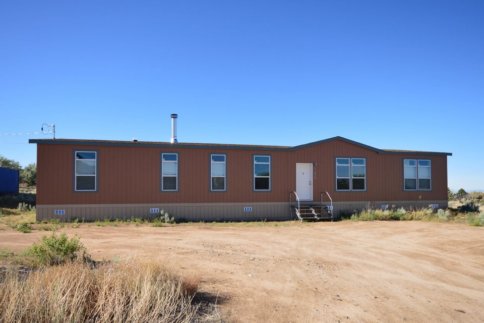 Located on a large lot in North Albuquerque Acres, this lovely 2015 Champion Manufactured home has a bright open floor plan with two large living areas including family room with gaslog fireplace. Kitchen has gas stove, microwave, pantry, breakfast bar and dining area. Spacious master Bedroom has large bath with large vanity with two sinks, tub and separate shower. Home has two additional bedrooms plus a study/office/4th bedroom.