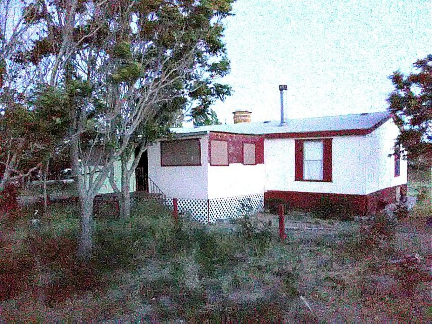 Great buy on this affordable property in the south valley. Situated on nearly a half acre, come see it today.