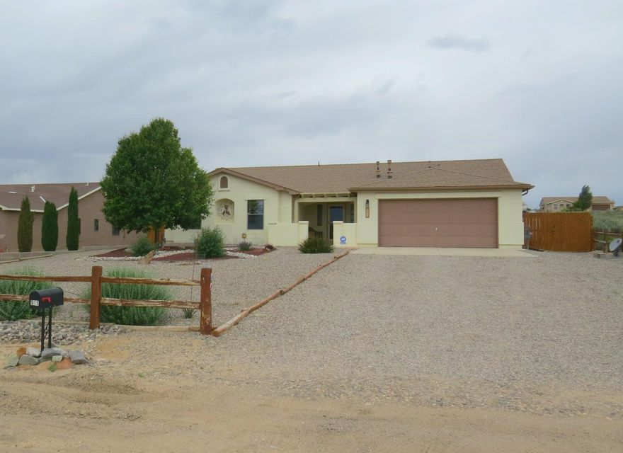 Southwestern oasis!Courtyard entry provides a perfect Sandia Mountain View!The current home owners have provided excellent care for this home & have invested in all the right upgrades. Split floor plan provides a private master suite with raised bathroom countertops,large shower & soaking tub.High ceilings,recessed lighting,rich color laminate flooring &tile provides a luxurious touch.  Carpet was recently replaced along with new windows.Complete with refrigerated A/C. If you love being outside you are going to be really excited about the low maintenance, yet colorful backyard. The pergola is ready for Summer enjoyment. Sitting on a large half acre lot provides endless options to the new owners. Don't forget to check out the oversized two car garage, with separate backyard access door.