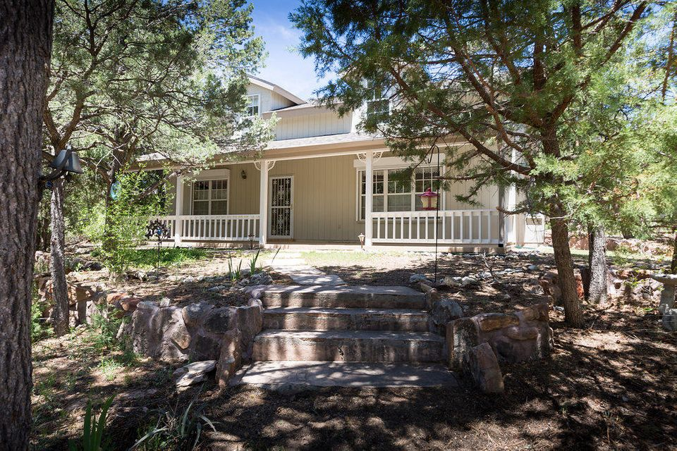 This lovingly maintained home is nestled in the tall pines on 2 private acres in quiet & secluded Heatherland Hills. Just a short 20 min. drive from ABQ but a world away from the chaos of town. Open, sunny floorplan with master downstairs. Kitchen w/ island, breakfast bar & large East facing bay window which brings in the morning light & views of the trees & abundant wildlife. Covered front & screened back patios. Porcelain tile throughout the downstairs including both patios, newer carpet upstairs. Electric metal security shutters roll down to secure all downstairs windows. ABC seamless gutters & rainwater collection system for landscape irrigation. Master bath completely remodeled in 2015. Exterior professionally painted in 2016, new roof in 2010, 12x16 Tuff shed barn installed in 2015.