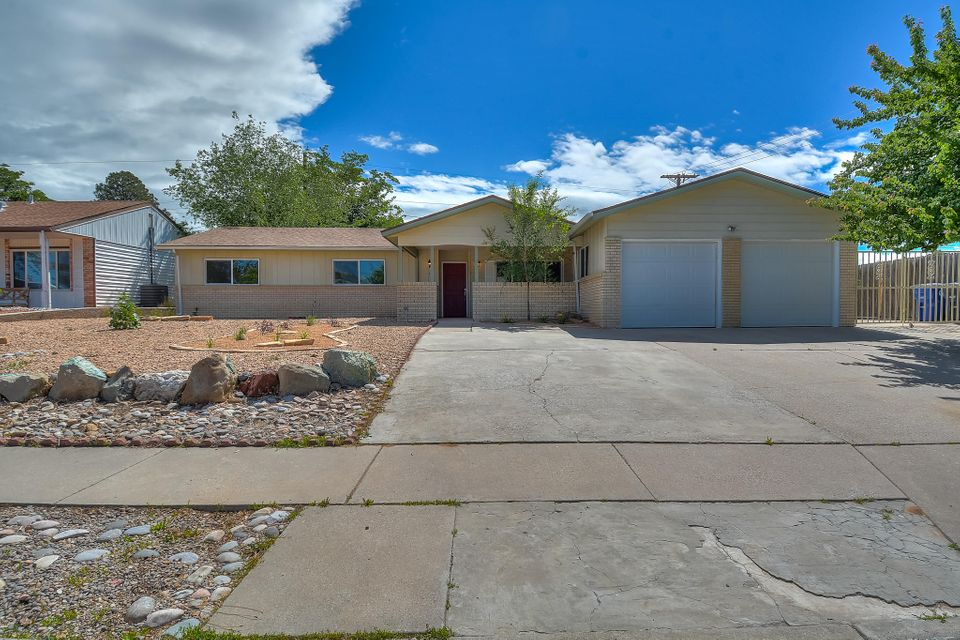 Completely Remodeled Charmer on Large Corner Lot!Come See this Super Clean Well Done Updated Home in The Heart Of Albuquerque.Featuring:All New Dual Pane Windows & Sliders,New Carpet in Bedrooms,New Tile in Bathrooms,New Laminate Bamboo Flooring,Newly Textured and Painted Ceilings,Fresh Paint,Updated Wood Burning Fire Place, New Fixtures Throughout and a Two Car Garage.Enlarged Kitchen Includes New Cabinets,Beautiful Granite Counters with Tiled Backsplash,New Stainless Steel Appliance; a Gas Cooktop/Oven, Microwave,and Dishwasher.This Bright & Open Floor Plan Has 4BR,2BA,Two Spacious Living Areas,& Laundry Room.Master & Hall Bathrooms Received Major Updates Including Custom Tiled Showers.Large Side For RV & Back Yard W/Built In BBQ Pit!All In Desirable School District,Come See This Today!