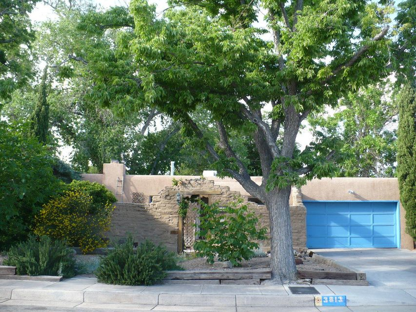 Prime location close to McDuffie Park, close to UNM, Nob Hill & major shopping centers. Front Yard offer a adobe courtyard wall for privacy.  Serene and peaceful backyard with a pond and balcony with mature trees.  Three bedrooms and a basement with a rec room and bedroom and bath. this home offers cove ceilings and hardwood flooring.Check out this home in Popular UNM neighborhood. Large Storage building in backyard.