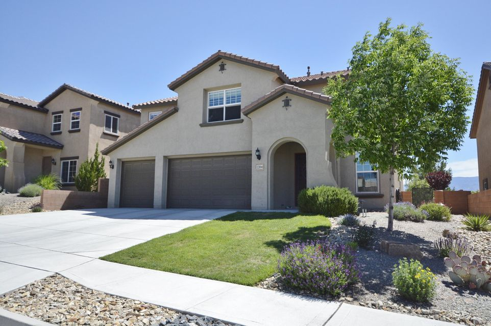WOW! What a VIEW of the Sandia Mountains and city lights!  Loma Colorado!  Popular Pulte Cordoba floor plan 4BDR/BA 3CG with 1BDR/1 FULL BATH on the main level plus a huge LOFT!  Incredible backyard entertaining space with covered & open patio, beautifully landscaped with trees, shrubs, flowers, and relaxing water feature, feels like another living area!!  Formal living and dining rooms, great room is open to the kitchen featuring solid surface countertops, upgraded cabinets, island, gas range, pantry & tile flooring. Large secondary bedrooms with walk-in closets. Master suite has amazing mountain views, separate shower, walk-in closet & linen closet and two sinks.  Back yard faces EAST!  3CG features a sink and built-in workbench!  Close to parks, schools, library and aquatic center